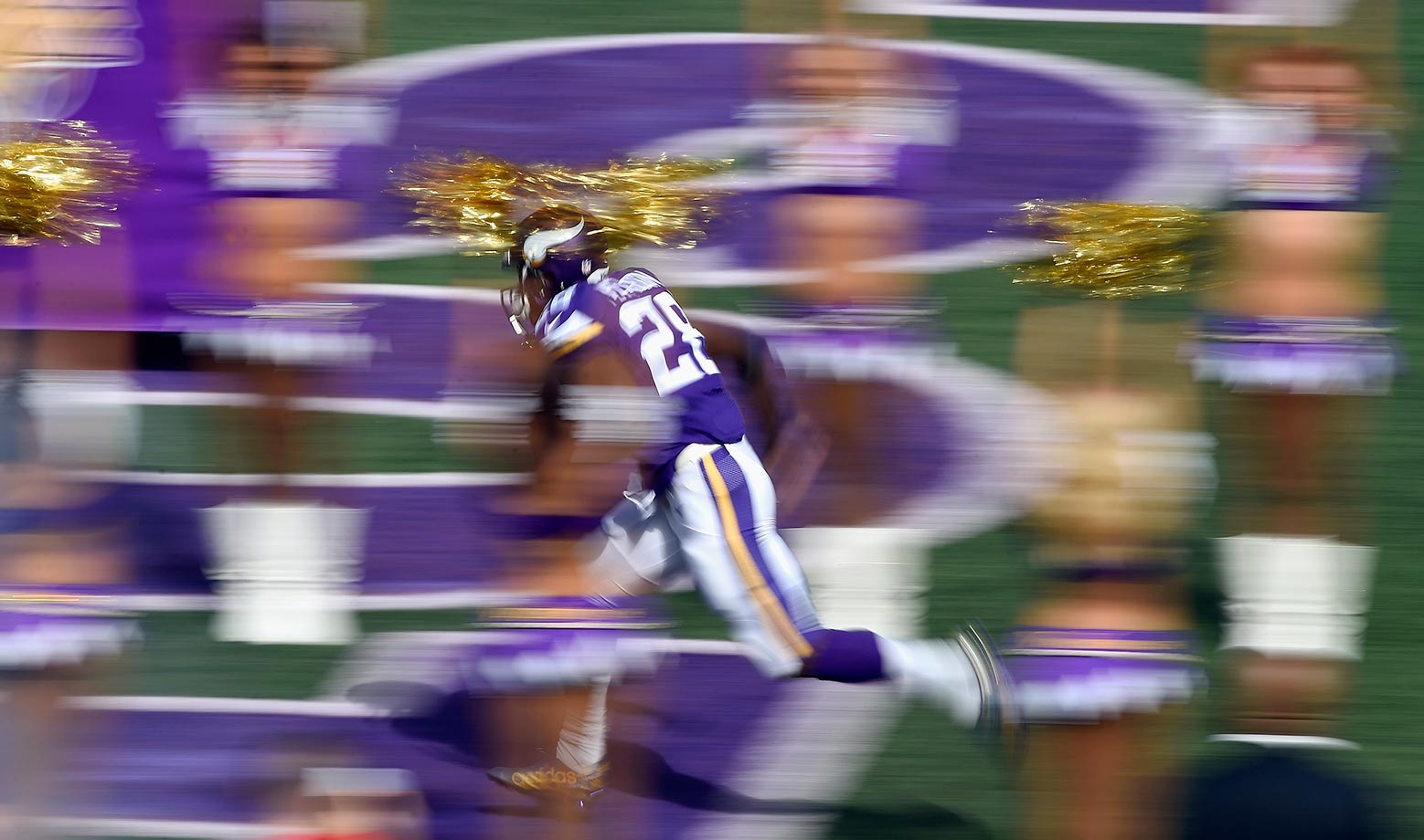 Adrian Peterson of the Minnesota Vikings runs onto the field before a game against the Detroit Lions.