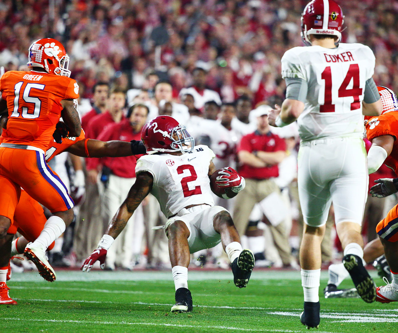 Derrick Henry gets pulled down from behind by a Clemson defender.