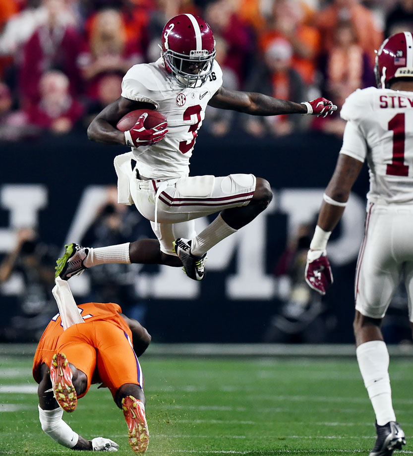 Calvin Ridley avoids a would-be Clemson tackler.
