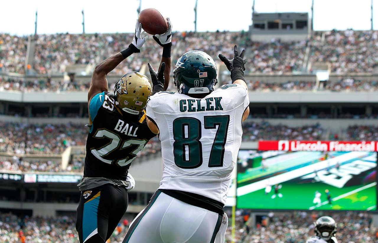 Alan Ball of the Jacksonville Jaguars intercepts a pass in the end zone intended for Brent Celek.