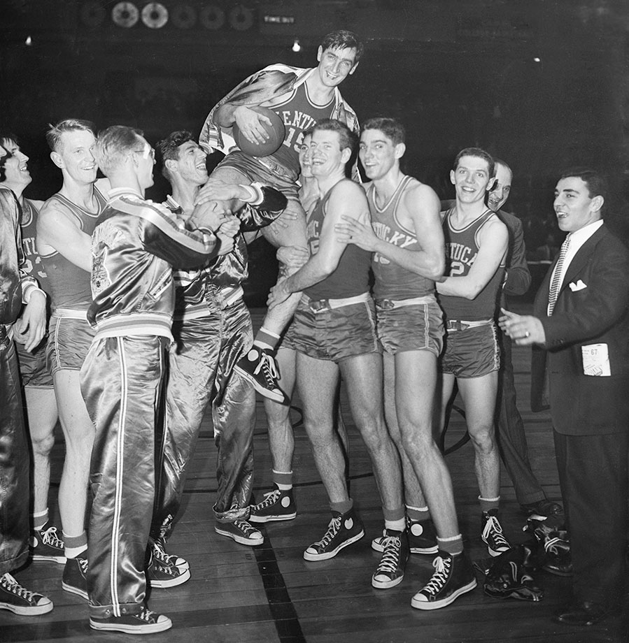 """As a freshman, Groza was averaging 16.5 points when he was drafted by the Army 10 games into the season to serve in World War II. Groza returned two years later two inches taller and 70 pounds heavier. The added size made him more dangerous on the court and he helped form the """"Fabulous Five"""" as Kentucky went on to win the 1948 national championship. Groza averaged 20.5 points per game the next season to lead the Wildcats to another national championship, becoming a member of the only Kentucky team to win back-to-back national championships. In the latter title game in 1949, Groza scored 25 points, more than half of Kentucky's points, in the 46-35 victory."""
