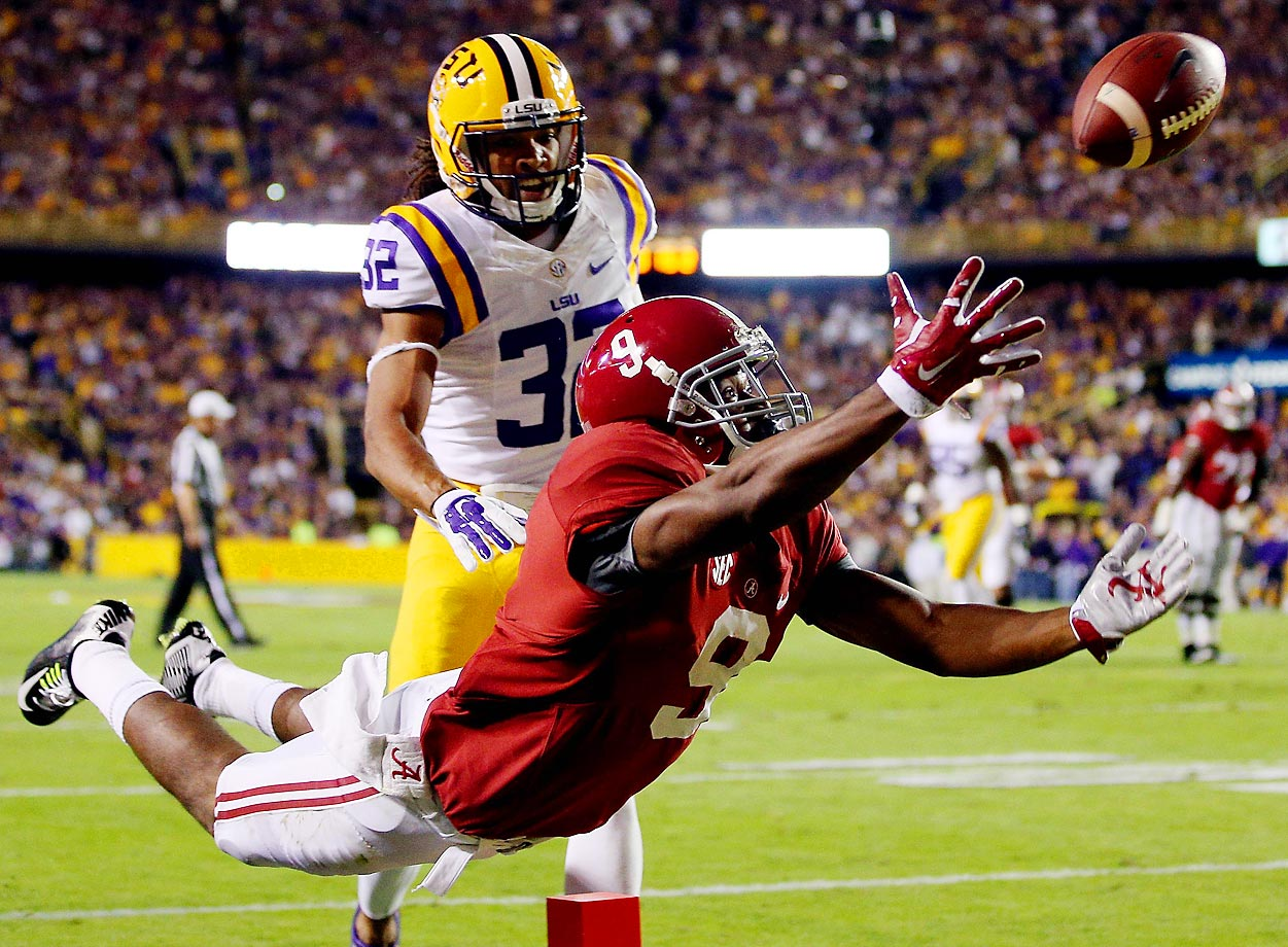 Amari Cooper of the Alabama Crimson Tide fails to make a catch in the second quarter as Jalen Collins of the LSU Tigers defends. Alabama won 20-13 in overtime.