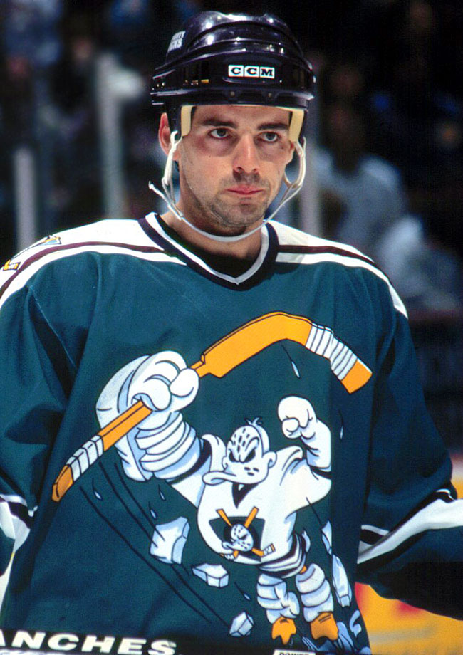 "This is the ""Showgirls"" of hockey sweaters, a debacle so gallingly bad that for some it comes all the way back around to great. Featured a cartoon version of the team's mascot leaping forward in an apparent 'roid-fueled rage along some of the worst name/number graphics ever."