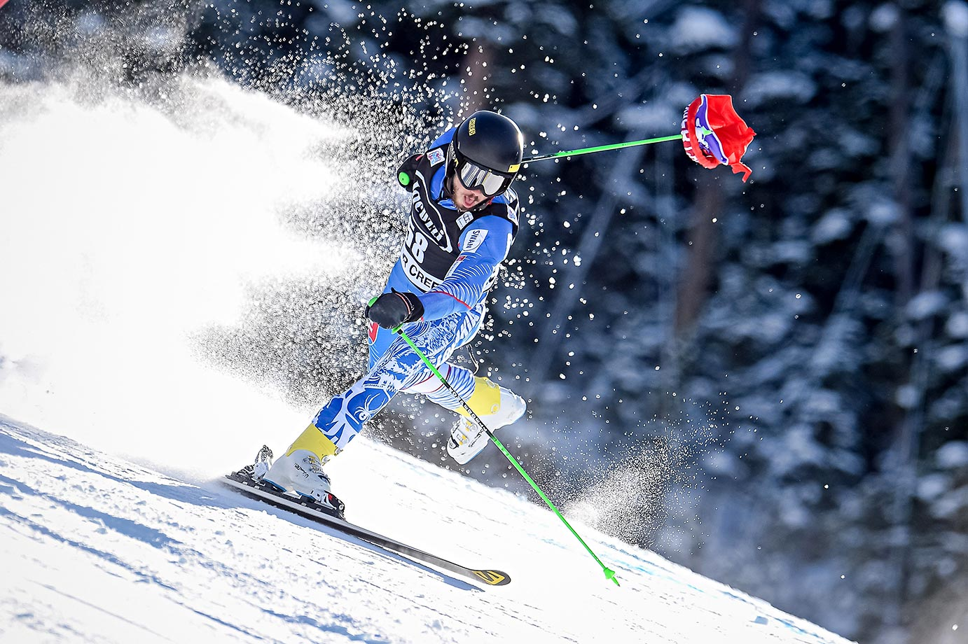Andreas Zampa of Slovakia loses a ski and grabs a flag with his pole during the Audi FIS Alpine Ski World Cup in Beaver Creek, Colo.