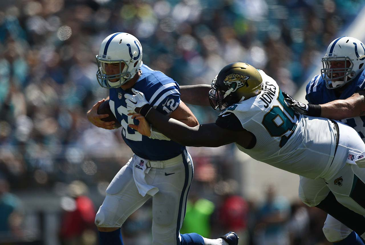 Andrew Luck tries to escape pressure on this play. He threw four touchdown passes against the winless Jaguars.