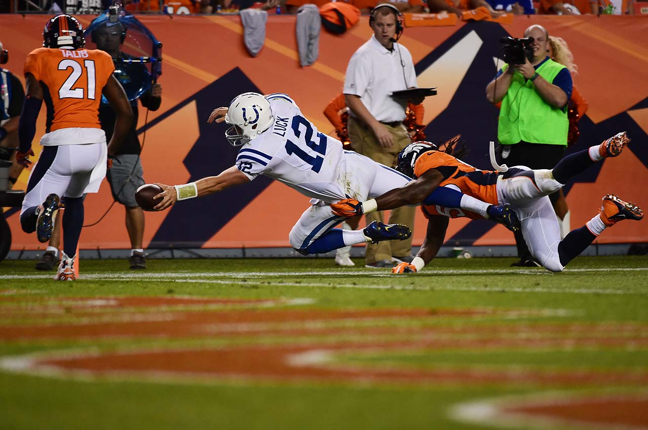 Andrew Luck managed to get this ball across the goal line for a touchdown before he went out of bounds.