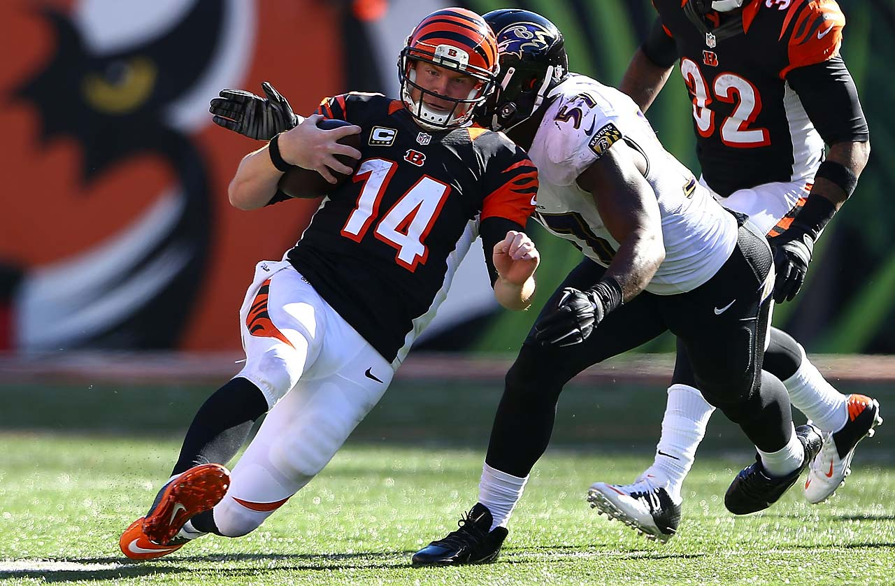 Andy Dalton heads into his slide after scrambling for yardage against C.J. Mosley and the Ravens.