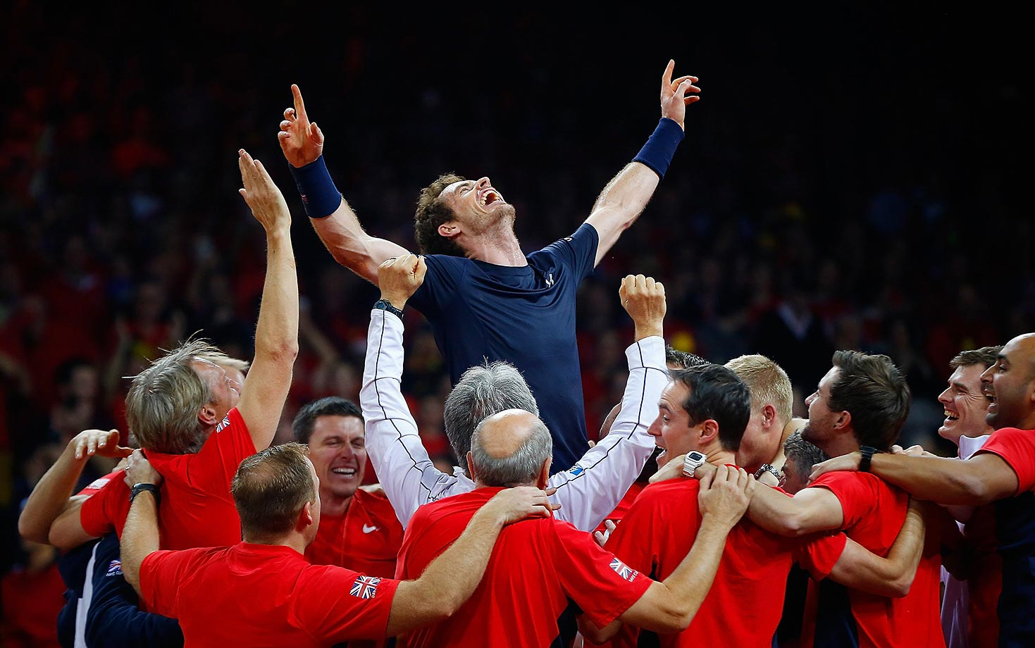 Andy Murray celebrates with his team after winning the Davis Cup for Great Britain.