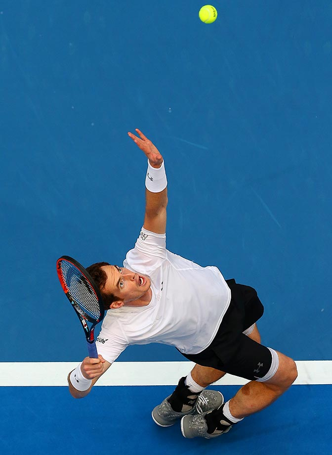 Andy Murray serves against Kenny De Schepper during the Hopman Cup.
