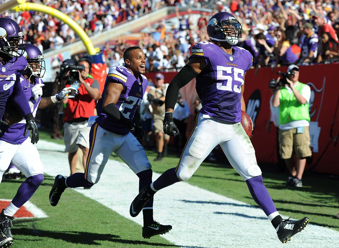 Outside linebacker Anthony Barr of the Minnesota Vikings celebrates his winning touchdown return with free safety Harrison Smith in overtime at Raymond James Stadium.