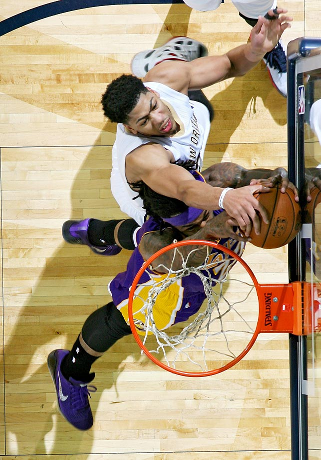 Anthony Davis of the New Orleans Pelicans blocks a shot by Jordan Hill of the Lakers.