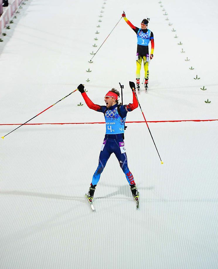 Anton Shipulin of Russia celebrates as he crosses the finish line at the Biathlon to win the gold medal in the 4x7.5 km relay.