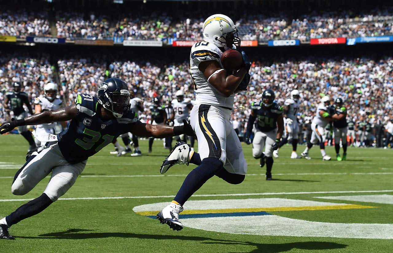Antonio Gates snares one of his three touchdown receptions in the Chargers' 30-21 win over visiting Seattle.