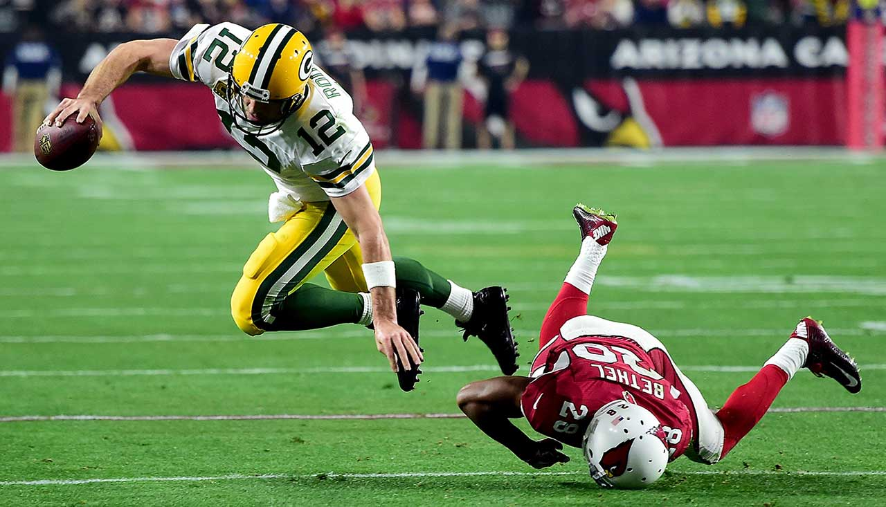 Aaron Rodgers was tripped on the play by Justin Bethel.