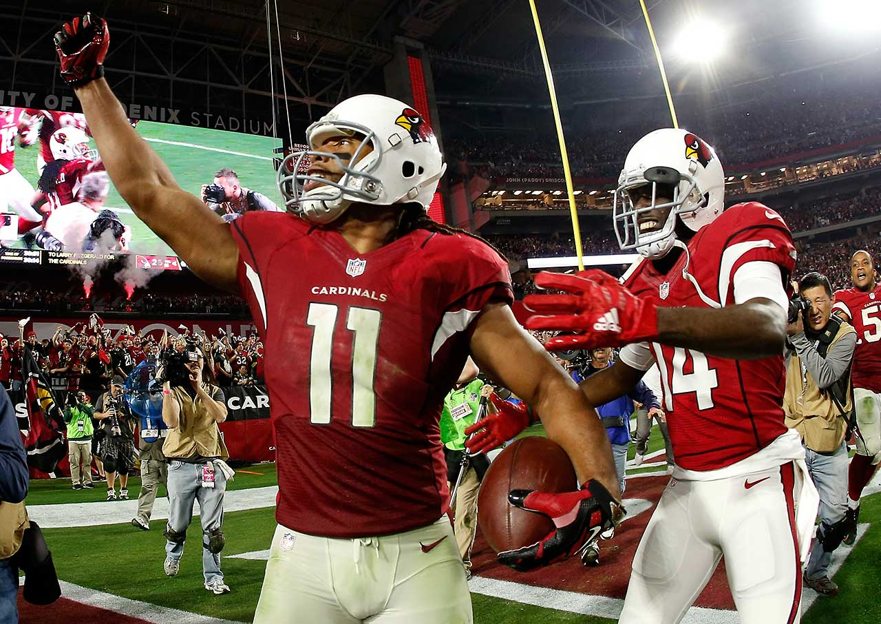 Larry Fitzgerald celebrates his five-yard touchdown catch in overtime that lifted the Arizona Cardinals over Aaron Rodgers and the Green Bay Packers in the NFL playoffs.