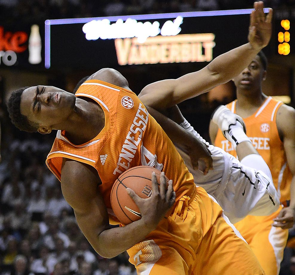 Tennessee's  Armani Moore is fouled by an almost invisible Jeff Roberson of Vanderbilt.