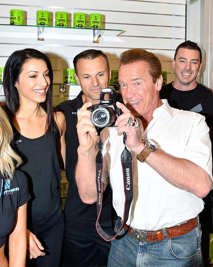 Arnold Schwarzenegger poses with staff at the Arnold Classic at The Melbourne Convention and Exhibition Centre.