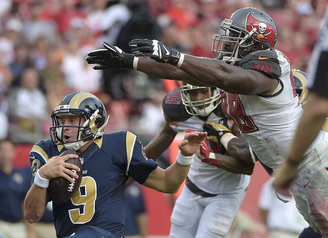St. Louis Rams quarterback Austin Davis is sacked by Tampa Bay Buccaneers defensive tackle Clinton McDonald. (