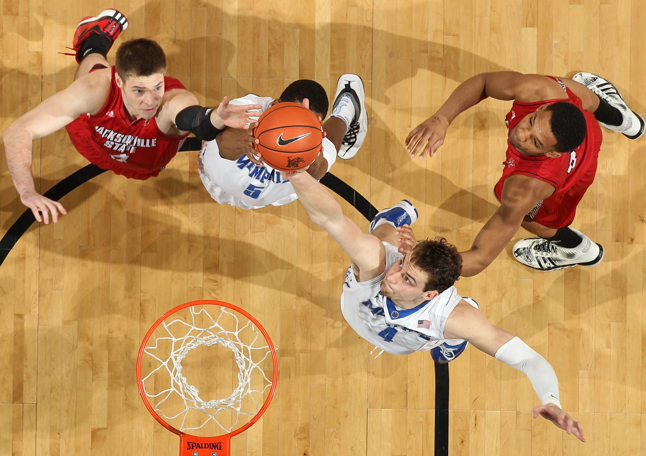 Austin Nichols (4) of the Memphis Tigers grabs a rebound against Joe Kuligoski of Jacksonville State. Memphis won 74-48.