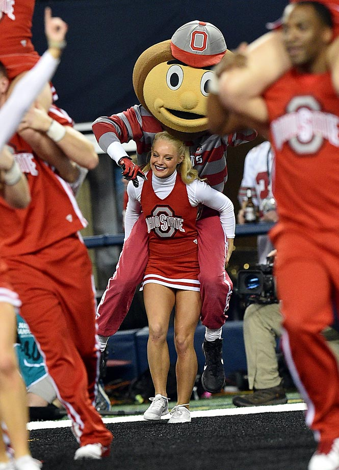 Ohio State's mascot Brutus piggy backs on a cheerleader during the National Championship game.