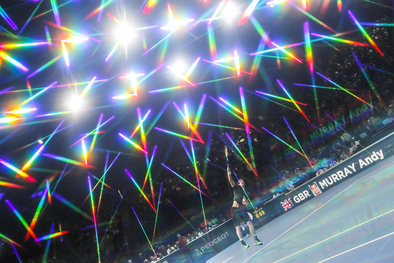 Prisms of light fly overhead during the round-of-16 match between Grigor Dimitrov and Andy Murray at the BNP Paribas Masters in Paris. Murray won 6-3, 6-3.