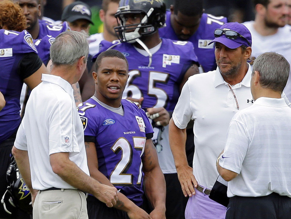 Ray Rice with team president Dick Cass (left) and owner Steve Bisciotti.