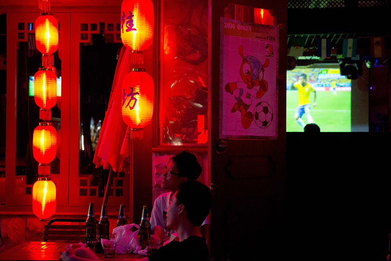 Chinese soccer fans watch the opening match of the 2014 World Cup between Brazil and Croatia, at a bar in Beijing, China.