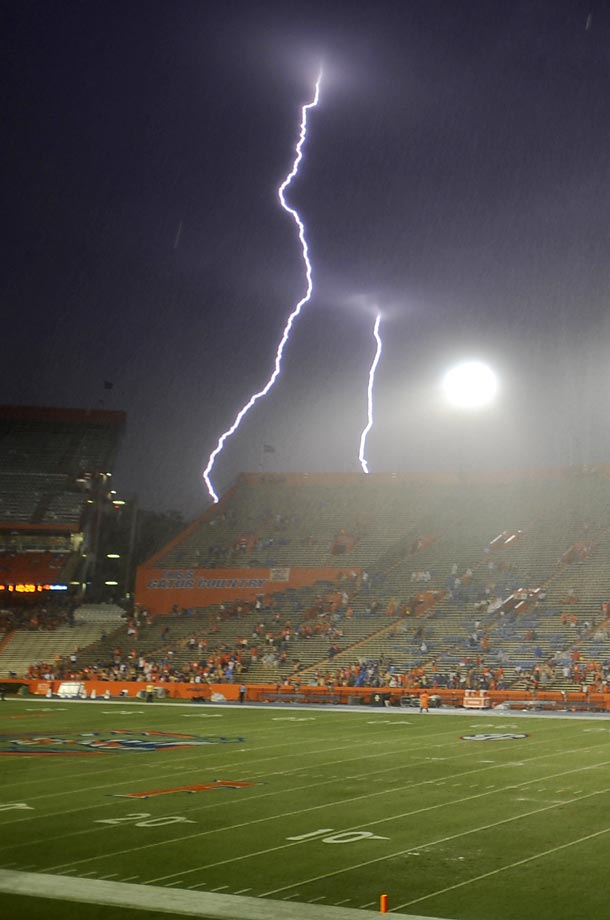 Lightning strikes near Ben Hill Griffin Stadium at Florida Field during a weather delay before the game between Florida and Idaho in Gainesville on Aug. 30.