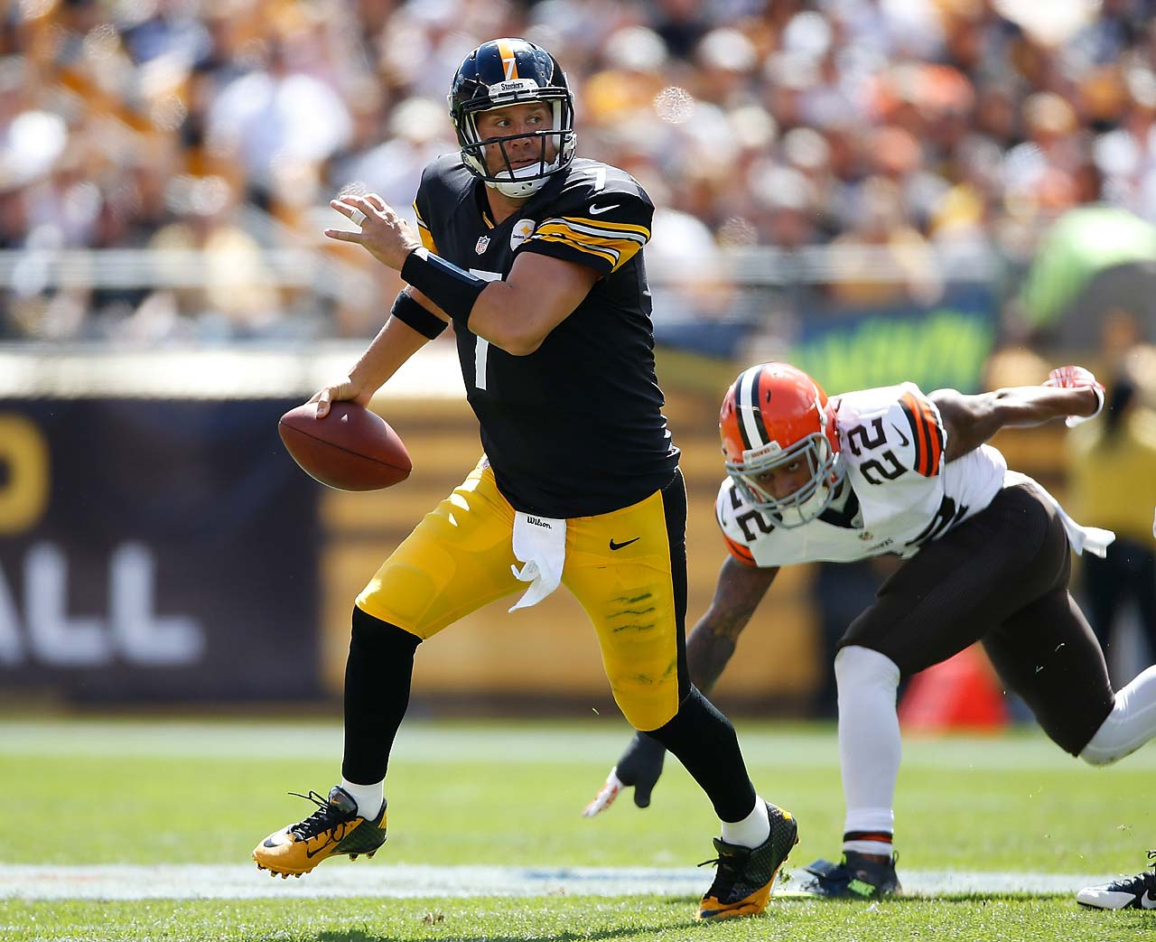 Ben Roethlisberger looks to pass downfield in front of Buster Skrine of the Cleveland Browns.