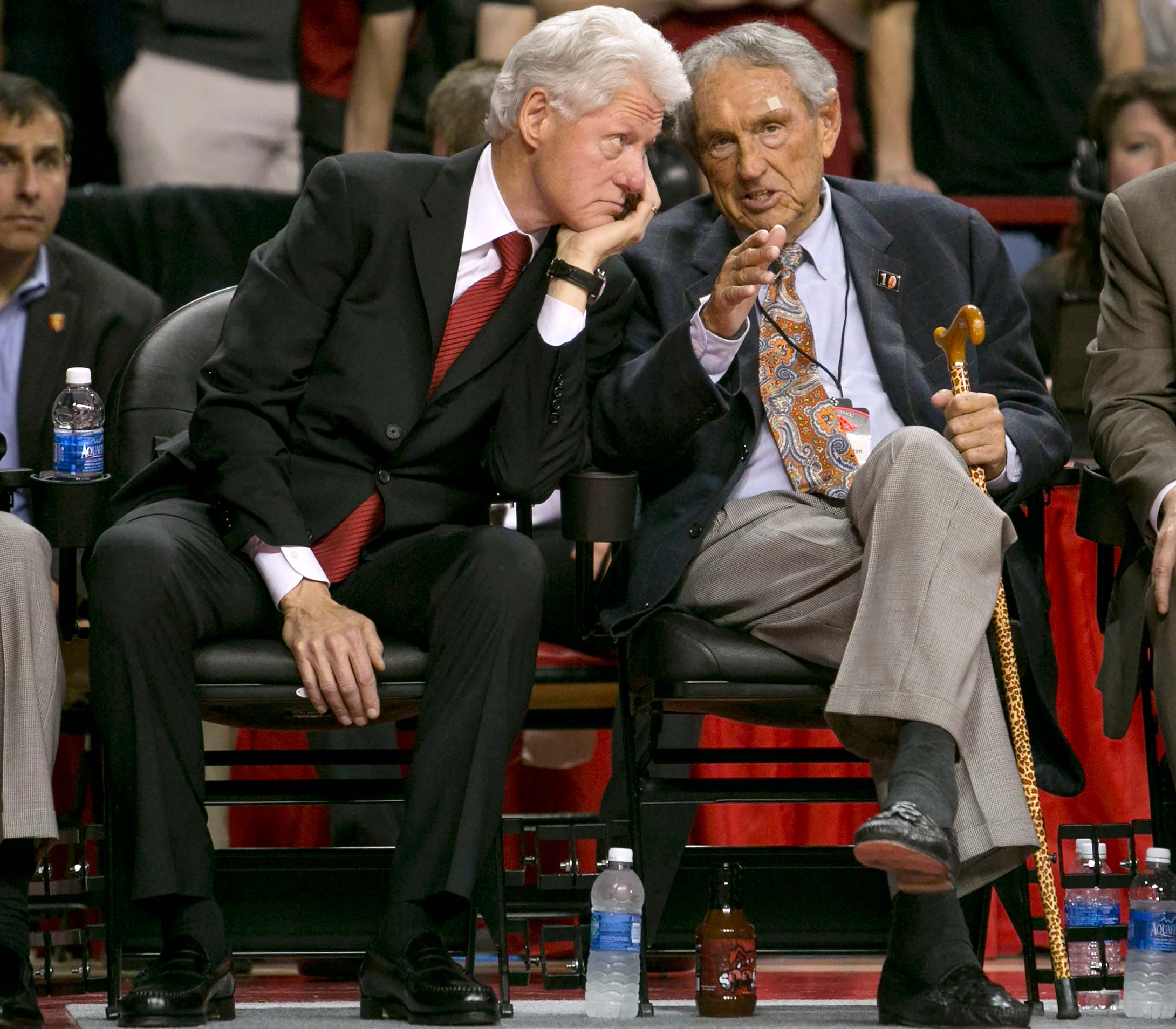 Former president Bill Clinton and former Arkansas coach Eddie Sutton during a 2014 game between Arkansas and LSU in Fayetteville, Ark.