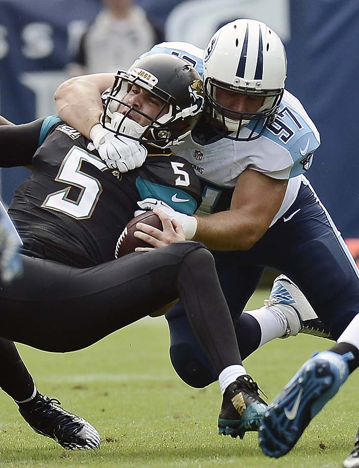 Jacksonville Jaguars quarterback Blake Bortles is sacked by Tennessee Titans defensive end Karl Klug for an eight-yard loss.