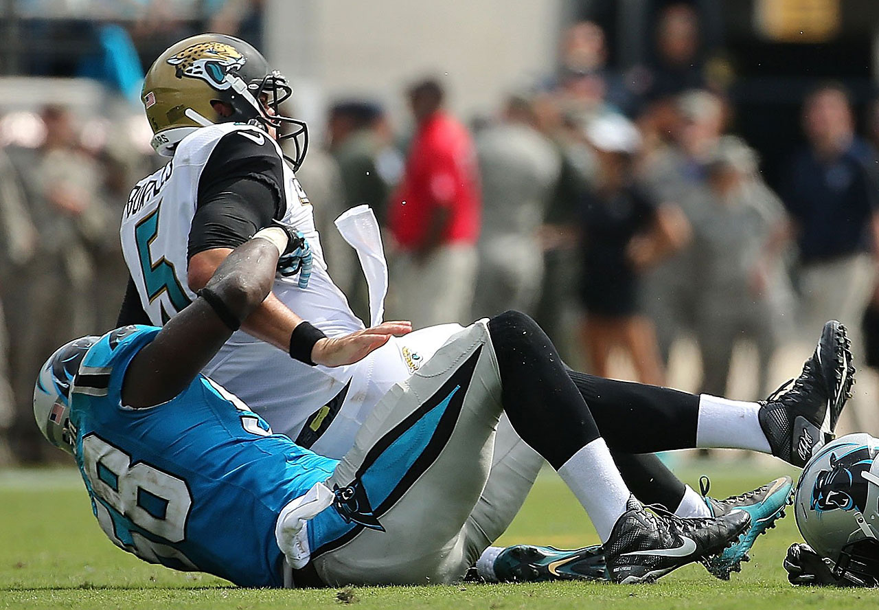 Blake Bortles of the Jacksonville Jaguars is sacked by Thomas Davis of the Carolina Panthers.