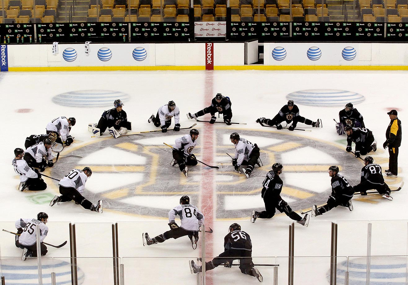 The Boston Bruins do a little stretching during their first day of full team training.