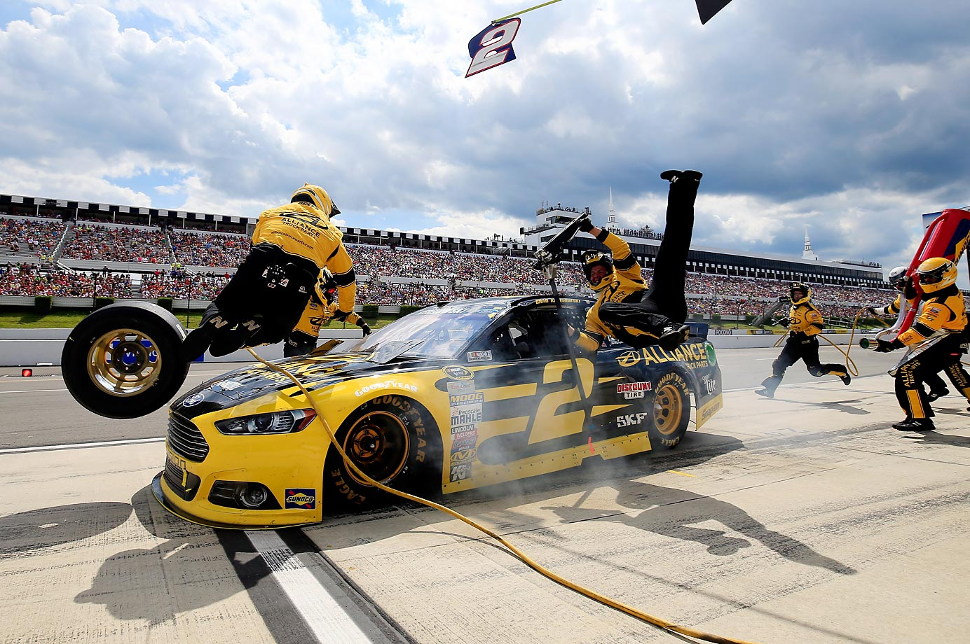 Brad Keselowski crashes into his crew on pit road during the NASCAR Sprint Cup Series Windows 10 400 at Pocono Raceway. No one was injured in the incident.