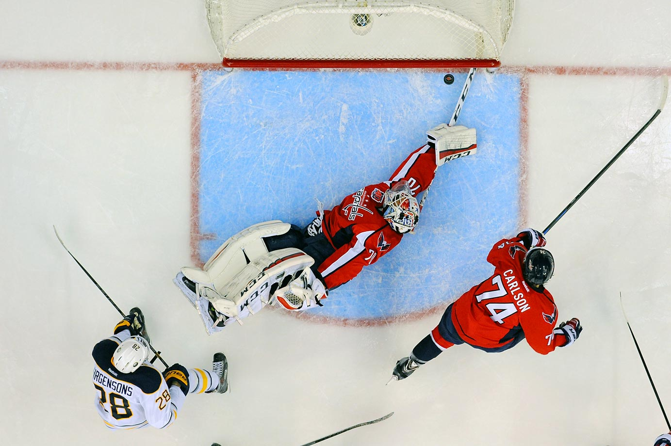 Capitals goalie Braden Holtby gives up this goal to Sabres center Zemgus Girgensons. The Sabres defeated Washington 2-1.