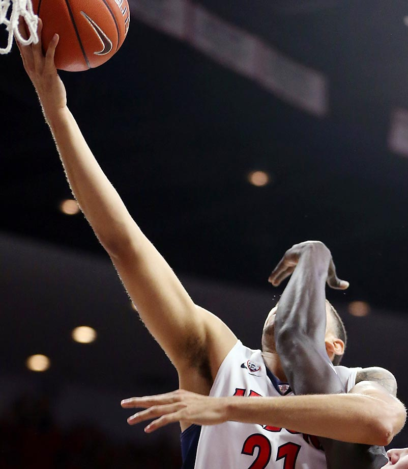 Arizona forward Brandon Ashley is walloped in a game against Oregon State.