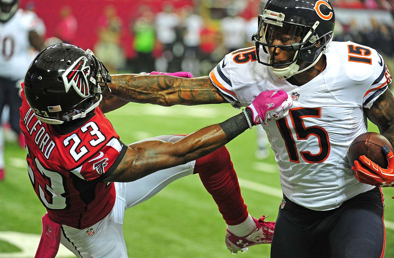 Brandon Marshall of the Chicago Bears shakes off the tackle attempt by Robert Alford of the Atlanta Falcons.