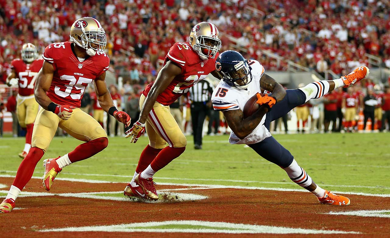 Wide receiver Brandon Marshall of the Chicago Bears catches a pass for a touchdown while defended by free safety Eric Reid.