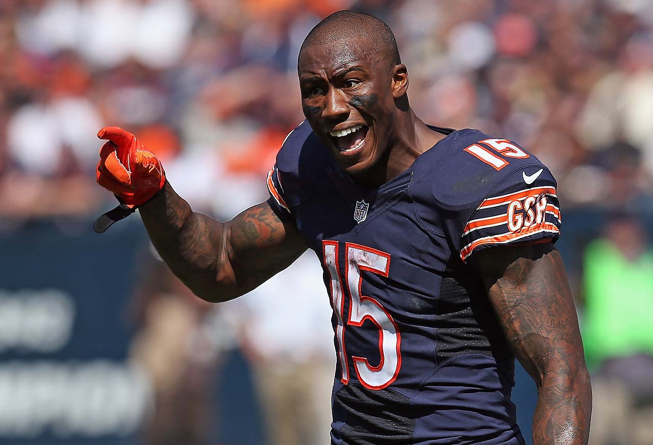 Brandon Marshall questions an incomplete pass call at the end of the third quarter. The call was challenged and overturned for a complete pass.