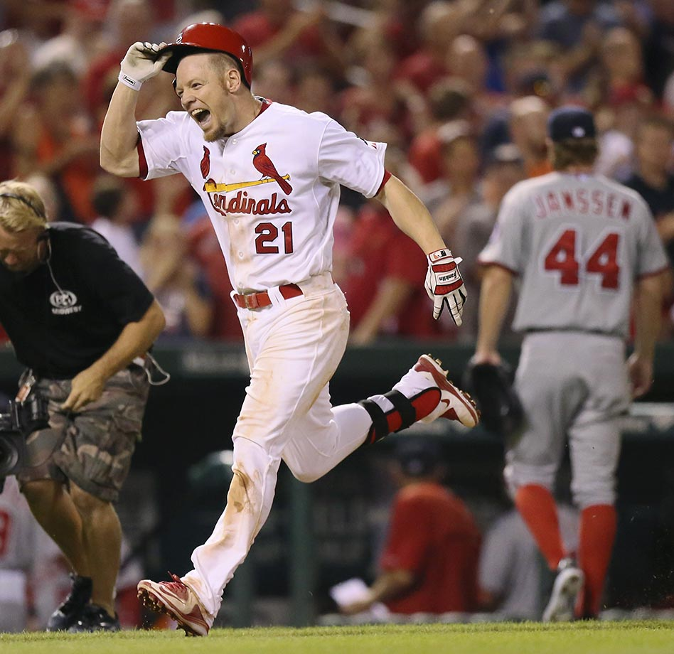 Brandon Moss of the St. Louis Cardinals rounds the bases after hitting a walk-off, three-run home run in the ninth inning against Washington Nationals pitcher Casey Janssen on Sept. 1. The Cardinals won 8-5.