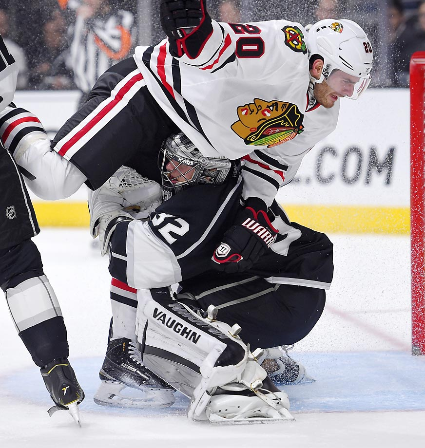 Brandon Saad of the Chicago Blackhawks collides with Jonathan Quick of the Kings.