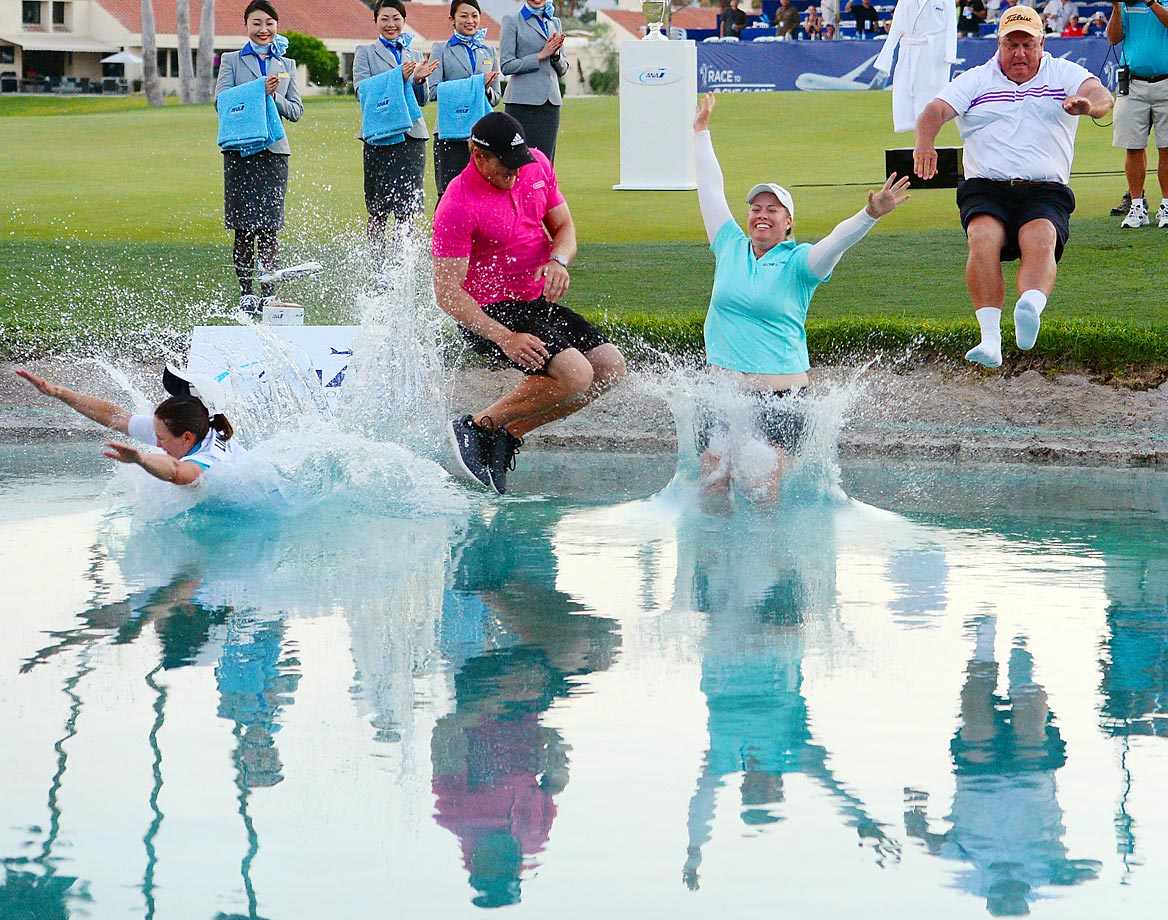Brittany Lincicome jumps in the water after winning the ANA Inspiration, on the Dinah Shore Tournament Course at Mission Hills Country Club.