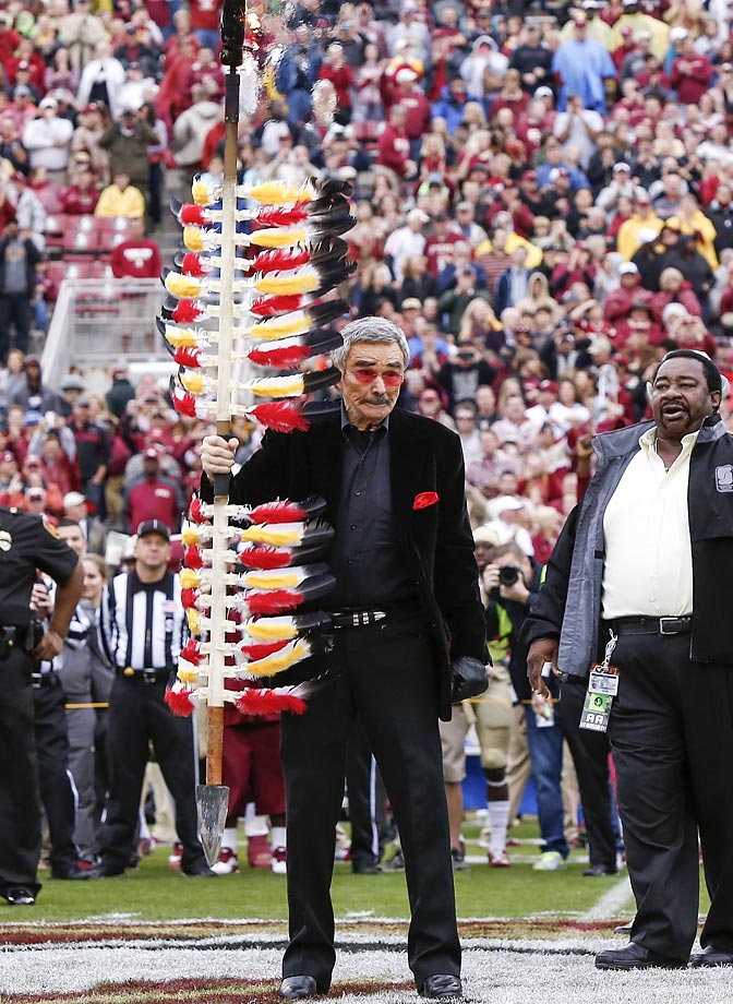 Former Florida State football player Burt Reynolds plants the spear midfield before the game against Boston College.