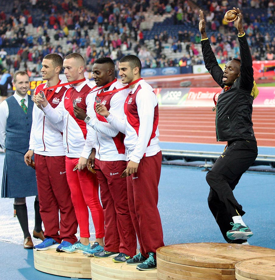 Usain Bolt photobombs the England team at the Commonwealth Games in Scotland.