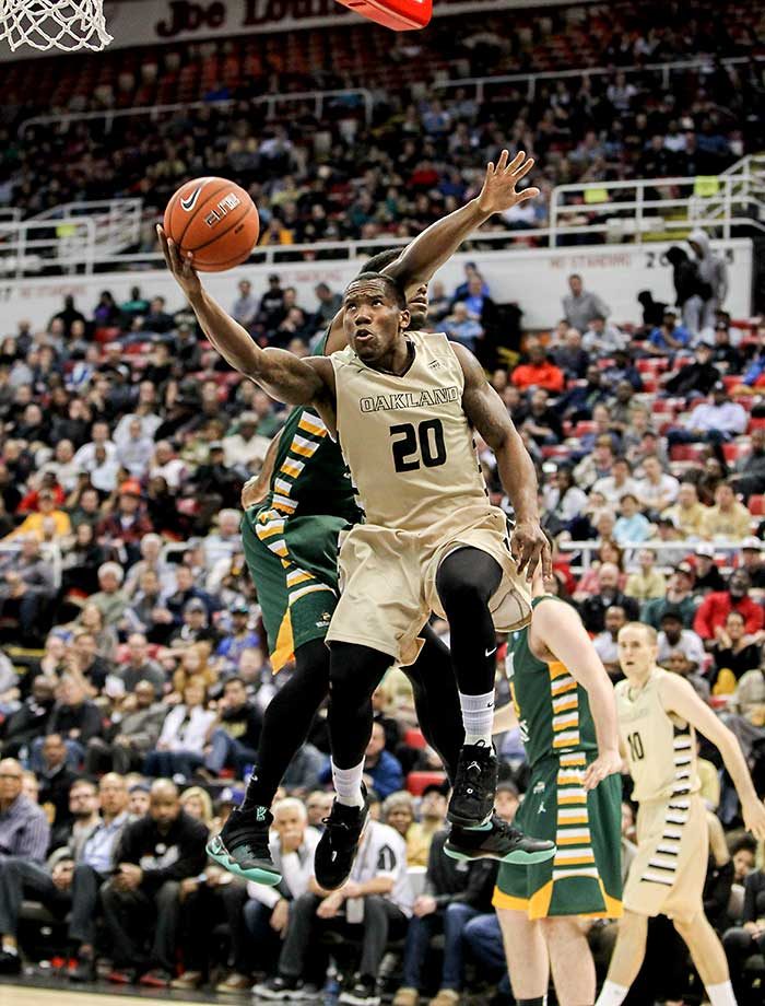 Oakland guard Kay Felder drives to the basket against Wright State guard Biggie Minnis during a Horizon League tournament semifinal.