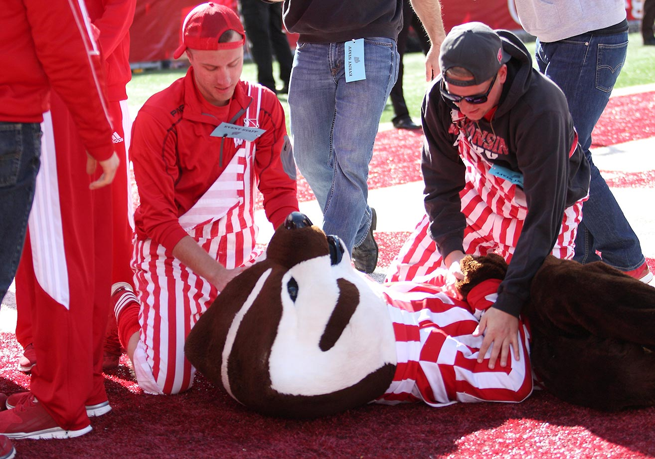 Bucky Badger gets extra attention in the end zone at the end of a game against Purdue.