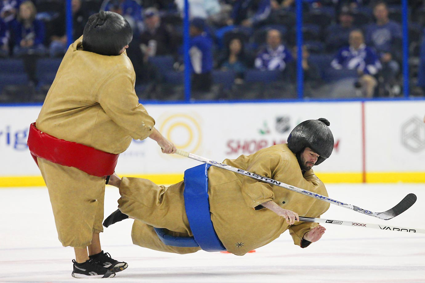 Tampa Bay Lightning fans wearing sumo outfits take part in a promotion during the game against the Carolina Hurricanes.