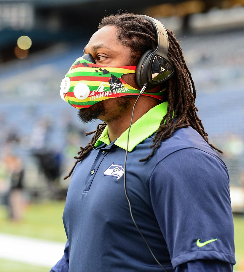 Marshawn Lynch of the Seattle Seahawks wears a training mask before a game against the Carolina Panthers.