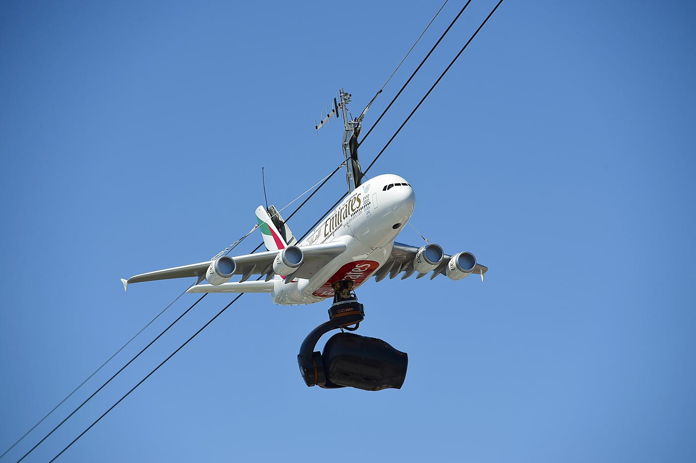 A remote camera hangs from a faux airplane at the French Open on June 6.