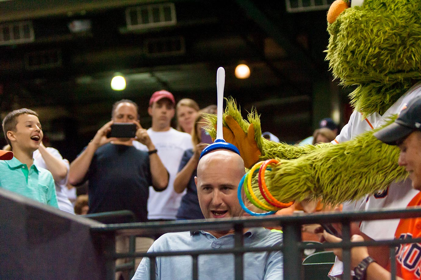 Houston Astros mascot Orbit having a little fun with a fan.